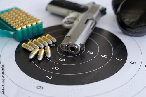 Fotografering Guns with ammunition on paper target shooting   practice