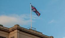 Union Flag Flying Against A Blue Sky (Union Jack)