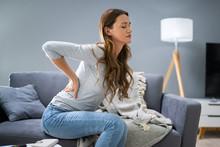Woman Having Backache While Si...