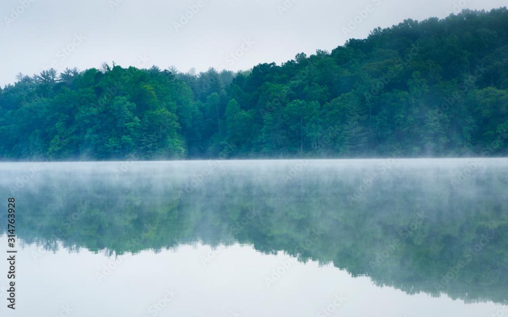 Fototapeta Early morning fog on a lake in Virginia USA