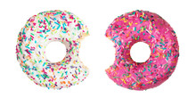 Set Of Two Bitten Donuts Decorated With Colorful Sprinkles Isolated On White Background