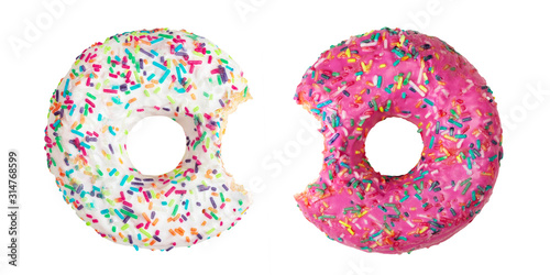 Photo Set of two bitten donuts decorated with colorful sprinkles isolated on white bac