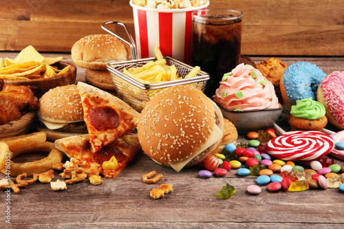 Fototapeta Unhealthy products. food bad for figure, skin, heart and teeth. obraz