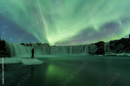 Photo Northern Lights (Aurora Borealis) above Godafoss Waterfall, Iceland