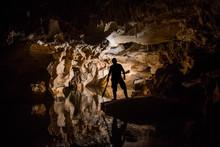 Figure Silhouette With Machete  In Cave