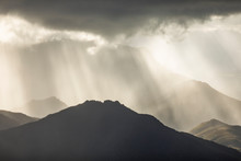 Heavenly Light Over Dramatic M...