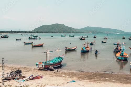 Fotografiet Fishing boats in the sea bay in Prachuap Khiri Khan district, Thailand