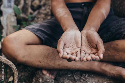 poor child or beggar begging you for help sitting at dirty slum Fototapeta