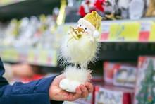 Choosing A Snowman Doll In The...
