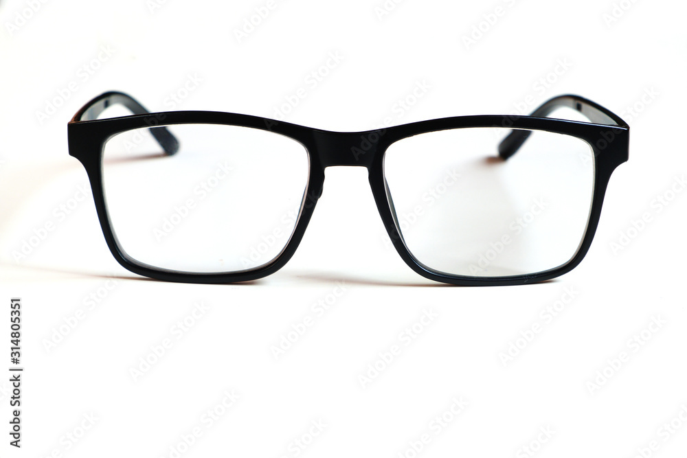 Fototapeta Transparent glasses, black frame isolated on a white clean background.