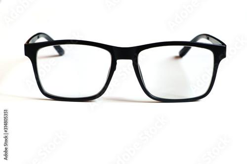 Obraz Transparent glasses, black frame isolated on a white clean background. - fototapety do salonu