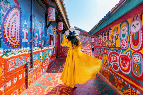 Woman standing at Rainbow village in Taichung, Taiwan. - 314806759