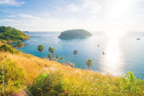 Sea shore with yellow grass sunset sky island view nature landscape