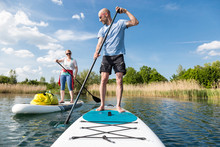 Couple On Stand Up Paddle Boar...