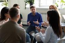 Diverse People Seated In Circle Participating At Group Therapy Session