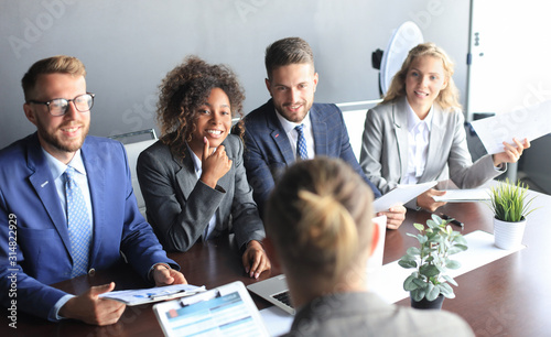 Photo Job interview with the employer, businessman listen to candidate answers
