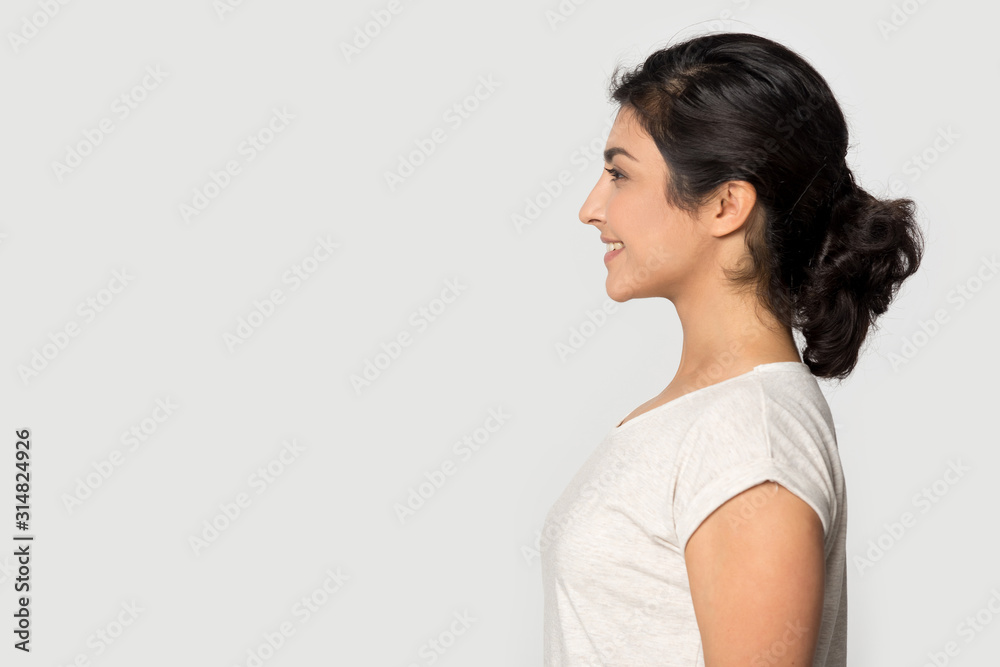 Fototapeta Side profile view indian ethnicity girl looking at empty copyspace.