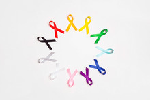 World Cancer Day Concept, February 4. Circle Of  Colorful Awareness Ribbons On White Background. Copy Space For Text.