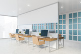 Fototapeta Kawa jest smaczna - White and blue open space office corner