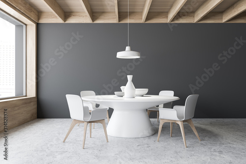 Gray dining room interior with round table - 314828974