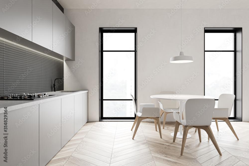 Fototapeta Loft gray kitchen with round table