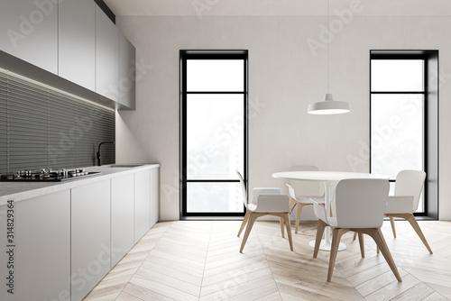 Obraz Loft gray kitchen with round table - fototapety do salonu