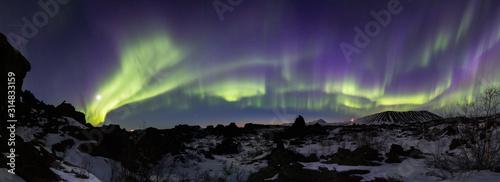 Fotografie, Obraz Northern lights above an arctic landscape