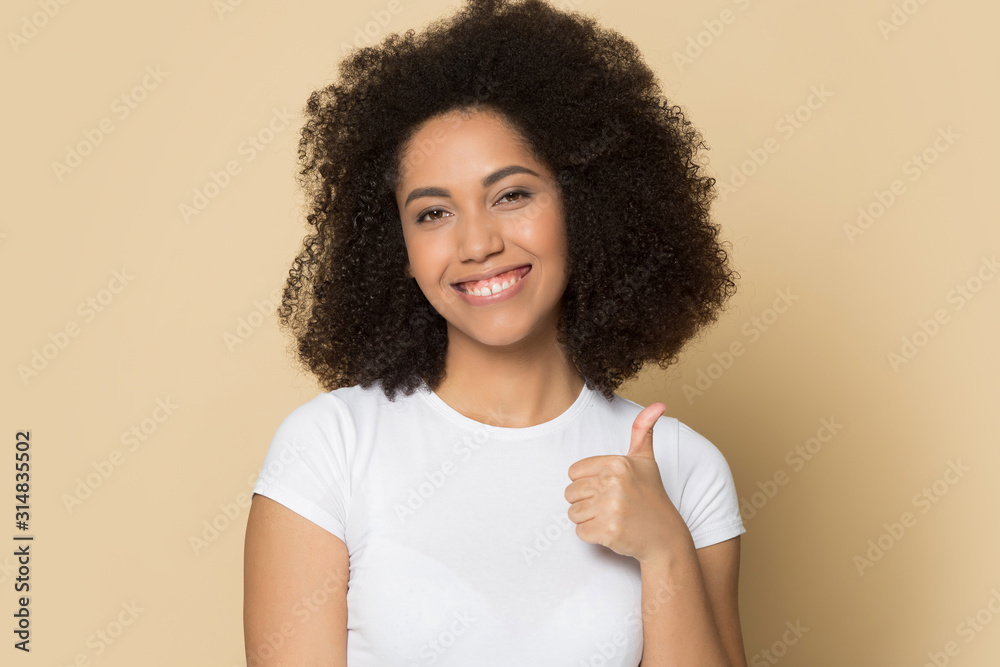 Fototapeta Young african american lady showing like, thumbs up gesture.
