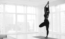 Sporty Woman Practicing Yoga In Tree Pose