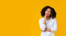 Doubtful Afro Girl Thinking Ab...