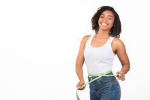 Portrait Of Young Black Girl Measuring Waist