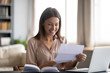 Smiling young woman read good news in letter