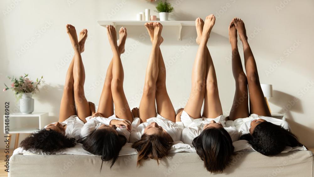 Fototapeta Diverse girls lie upside down celebrate hen party