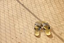 Flip Flops On The Old Concrete Floor.