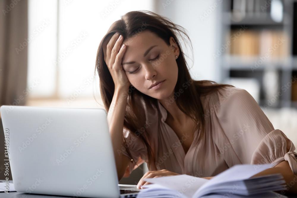 Fototapeta Tired young woman fall asleep working at laptop