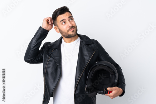 Man with a motorcycle helmet having doubts and with confuse face expression Fototapeta