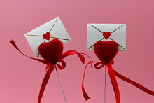 Red Hearts With Red Ribbon And Love Letter On Pink Background. Valentines Day Concept.