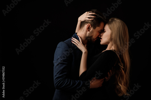 elegant couple in the tender passion. man and beautiful woman kissing