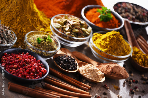 Fototapeta  Variety of spices on kitchen table