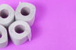 canvas print picture - Toilet paper close-up. White paper for household and rubbing the anus from feces. Toiletries on purple background