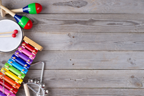 music accessories for children on wooden background. top view. - 314884513