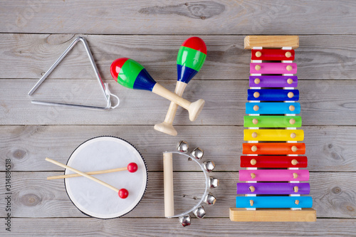 music accessories for children on wooden background. top view. Fototapeta