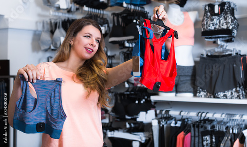 Female 20-24 years old is choosing sports underwear