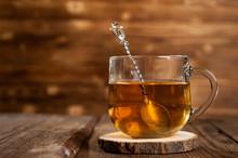 Mug With Tea On A Wooden Back...