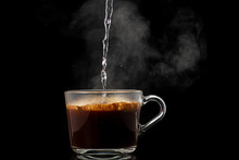 Making Instant Coffee In A Mug On A Black Background