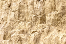 Sandstone And Clay Wall Covered With Erosion And Cracks