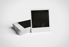 Stack Of Instant Photos On Whi...