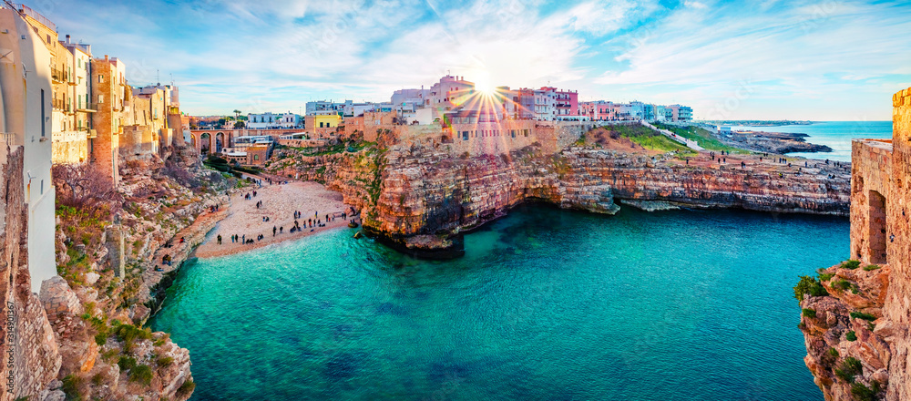 Fototapeta Panoramic spring cityscape of Polignano a Mare town, Puglia region, Italy, Europe. Marvelous evening view of Adriatic sea. Traveling concept background.