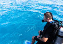 Man Getting Ready For Scuba Diving In The Sea