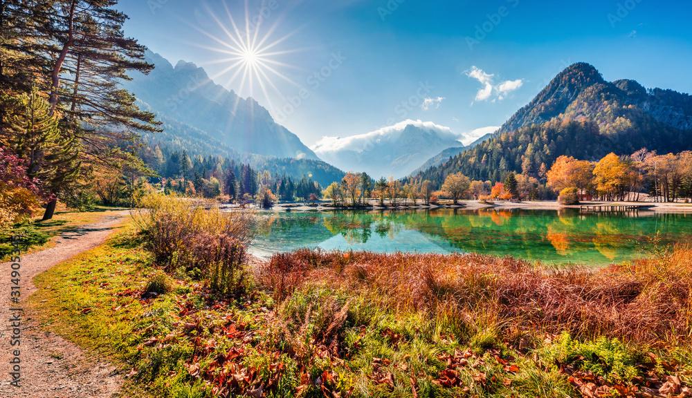 Fototapeta Sunny morning view of Jasna lake. Attractive autumn scene of Julian Alps, Gozd Martuljek location, Slovenia, Europe. Wonderful landscape of Triglav National Park. Traveling concept background.